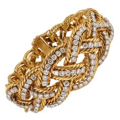 Boucheron Diamond Gold Platinum Braided Bracelet | From a unique collection of vintage more bracelets at http://www.1stdibs.com/jewelry/bracelets/more-bracelets/