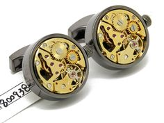 The Vintage Steampunk Cufflinks with Functioning Watch Movement are a pair of men's cuff links with working watch mechanisms embedded in them.