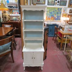 SOLD. $155. vintage antique small painted shabby chic hutch c. 1920. painted white with blue background. three shelves - two doors at bottom - curved legs. top shelf has plate groove. so cute! would be great in your kitchen, bathroom, living room, or dining room. very good condition.