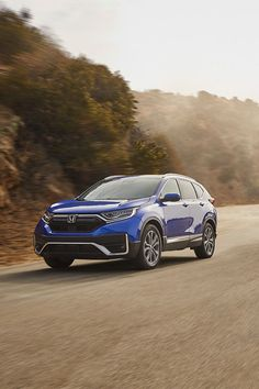 Bank turns like a pro with the Honda CR-V. Roof Rails, Cr V, Honda Cr, Black Side, Electric Motor, Rear Seat, Tail Light, Interior Accessories, Grey Leather