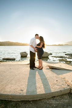 Gorgeous couple's maternity shot!  Kissing in front of the lake at Borelli Park in San Dimas.  Photo by Sarah Dupree.
