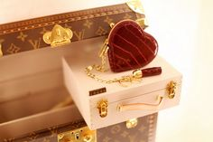 louis vuitton case and cute love heart purse