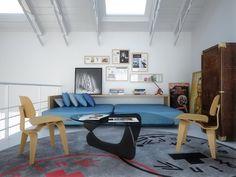 intérieur plan ouvert de style industriel avec une table basse et des chaises en bois, tapis rond gris, canapé bleu et armoire vintage