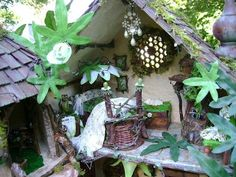 """This enchanting One Of A Kind  fairy home is made from SOLID WOOD with a textural, 4 step paint and plastered exterior with natural BARK s..."