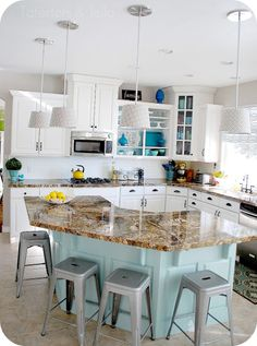 Aqua and White Kitchen. Love the curved island!