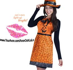 "Halloween Glam Apron AVON EXCLUSIVE A festive look for the Halloween party. The cat's eyes light up at the push of a button. 34"" W x 30 3/4"" L. Button-cell battery included. Polyester. Spot clean. Imported. www.YourAvon.com/AvonOohLaLA"