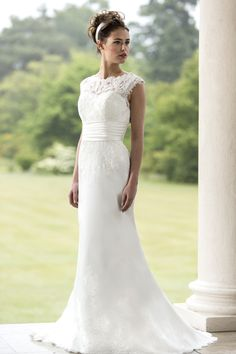 True Bride - W121 Slinky satin bridal gown with lace covered bodice, satin waistband and slim fitting satin skirt with stunning lace hem detail. Lace keyhole to back with zip and button trim.  To make an appointment to view this dress please call 01273 736622 http ://www.oceanbride.co.uk/appointments