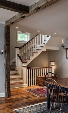 Loving the staircase and the wood beams. I also am loving the wood plank floor. #farmhouse #staircase