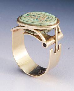 Ring | Joseph Gatto.  14 kt gold, glazed Egyptian scarab, ebony inlays.   c. 1973