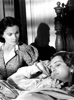 Vivien Leigh as Scarlett O'Hara and Olivia De Havilland as Melanie Hamilton Wilkes in 'Gone With The Wind' (1939).