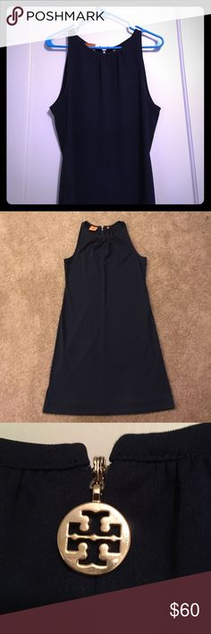 "Tory Burch sleeveless shift dress in navy • sz med This Tory Burch sleeveless shift dress is navy with gold hardware. The dress is a medium (would most closely fit an 6/8 depending on how you like shift dresses to fit. This is 35"" from neckline to hem and 17"" from underarm to underarm. 100 percent polyester, nice and light weight. Dress does have belt loops. Tory Burch Dresses Midi"