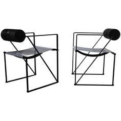 Pair of Seconda 602 Armchairs by Architect Mario Botta   From a unique collection of antique and modern chairs at https://www.1stdibs.com/furniture/seating/chairs/