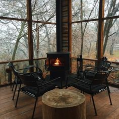 wood burning stove on the cabin screened porch #outdoorliving #cozy