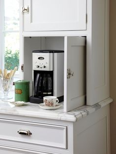 """Declutter with an Appliance Garage ... """" Include an electrical outlet at the back of the cabinet for convenience."""""""