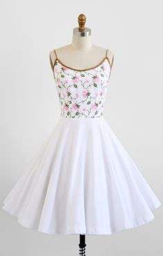 vintage 1950s white cotton pique party dress with pink embroidered blossom