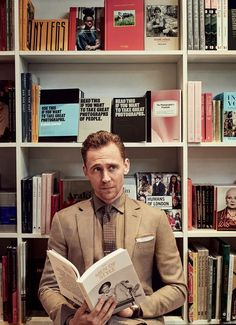 Tom Hiddleston reading a book on style with Bowie on the cover, YES!