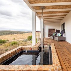 Marvel at the picturesque surroundings while relaxing in a lovely wood-fired tub on Blue Crane Farm Lodge's patio. This lovely lodge is on the slopes of the Houwhoek Mountains close to Botrivier.   #woodfiredtub #tubonthepation #patio #weekend #weekendfeels #mountains #mountainview #lodge