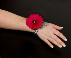 Bling never looked so good…. Shake things up with this hot pink gerbera daisy corsage accented with flash black ribbon, a river of diamonds and a Rock Star Dazzle Bracelet! Gerbera Wedding, Wedding Flowers, Eastern Floral, Pink Gerbera, Flower Centerpieces, Dance The Night Away, Black Ribbon, Flower Delivery, Corsage