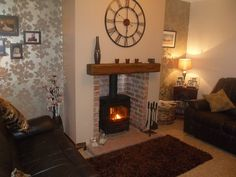 Juno 5kw DEFRA stove with quarry hearth, brick chamber and solid oak beam