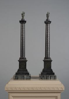 A pair of black marble columns from Trajan's Column in Rome by the workshop of Benedetto Boschetti, Mid-19th Century.