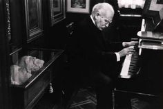 """David """"Chim"""" Seymour       Conductor and Pianist Arturo Toscanini, Age 87. In the Library Case Behind Him are the Death Masks of Beethoven, Wagner, and Verdi. Milan, Italy      1954"""