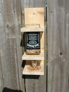 Jack Daniels Whiskey Bottle Bird Feeder. @Makayla Jennings Jennings Jennings Jennings Oei.  And this!