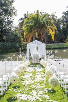 Photography: Koman Photography - komanphotographyblog.com/ Ceremony Venue: Fullerton Arboretum - www.fullertonarboretum.com/   Read More on SMP: http://www.stylemepretty.com/california-weddings/2014/03/29/vintage-whimsical-wedding-at-fullerton-arboretum/