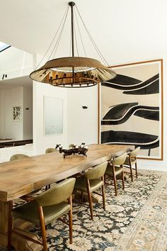 Love the idea of having a rug in the dining room