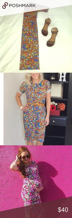 LuLaRoe Julia dress This dress can be worn so many ways! Very stretchy material, but not see through. Super comfortable no matter your size, very flattering on any body type!  Dress up with booties, sandals or heels. This is the most comfortable piece of clothing you'll own, I just have too many. Worn once for pregnancy photos and in perfect condition.  This dress does have black in the pattern. LuLaRoe Dresses Midi