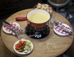 """""""The #Fondue Room at Café Select: The once-secret back room of this Soho spot has been converted into a 12-seat, melted-cheese hideaway."""""""