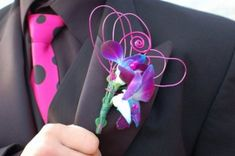 Prom Boutonniere of dyed dendrobium orchids and deco wire...........Great idea for the fall homecoming games and dances!