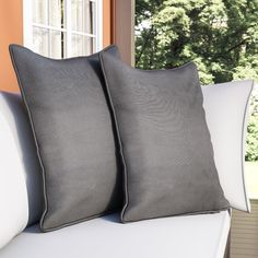 Add a touch of style and comfort to indoor furnishings with this set of two twill floor pillows. The pillows feature an elegant corded style and a removable insert.