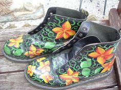 "LADIES SIZE 7"" DOC MARTENS 6 EYELET BOOTS WITH NO LACES IN A FLOWER PATTERN MADE IN ENGLAND AND WORN SEE PHOTOS BUT IN GOOD CONDITION. 
