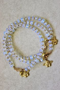 Angel bracelet, glowing opalite stacking bracelet with gold cherub angel charms, Indian bell clasp