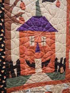 Sew Spooky Halloween Quilt by Lorena Norris, quilted by Natalie Thompson.  Pattern by The Quilt Company.  Closeup photo by Quilt Inspiration.