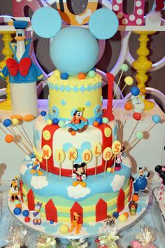 Mickey Mouse and Friends 1st Birthday Party Cake with baby blue Mickey silhouette as the cake topper.