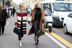 90+ Outfits That Are All About The Shape #refinery29  http://www.refinery29.com/2015/03/83106/milan-street-style-mfw-2015#slide-20  Holding hands means you get to take credit for your friend's outfit as well as your own. A two-for-one, if you will.Fendi coat, Carolina Wyser jeans.