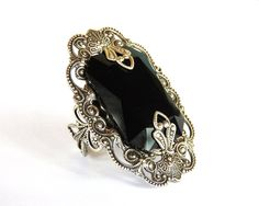 Large Statement Ring, Dark Red Gothic Ring, Burgundy Swarovski Ring, Silver Filigree Ring, Victorian Gothic Ring, Vintage Style Ring, Gothic Jewelry by https://www.etsy.com/shop/LeBoudoirNoir  Bold yet elegant and feminine, this spectacular ring will make a statement !! It features a grandiose sparkling octagon Swarovski jewel, nested into a gorgeous, intricate and delicate oval silver stamping, with ornate filigree patterns. Two delicate silver embellishments, embraces th...