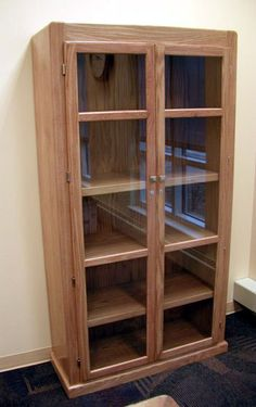 Glass-enclosed bookcase from Dickinson