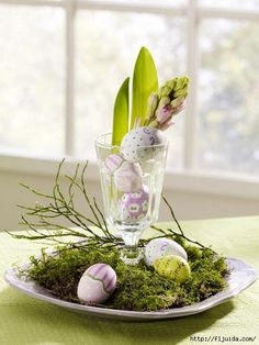 What cute idea to use glass stemware for a vase create a very elegant, but simple centerpiece. This one is great for Easter, but change up the contents with pinecones, or other relevant items for different occasions.