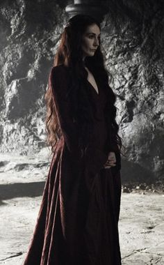 Melisandre stood there in silence, listening to the King's speech yet paying no attention to the words.  She was in deep thought, contemplating how she felt about the whole battle fiasco.  Part of her knew this loss was only a piece of a bigger puzzle, but telling that to someone who didn't possess foresight or faith in it, was useless.