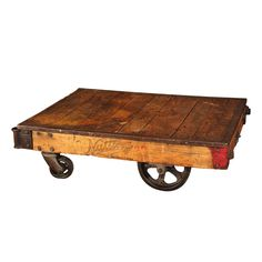Refinished Nutting Factory cart, cast wheels outlined with rubber, top bordered with steel