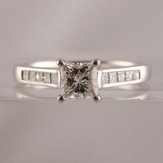 Princess cut diamond engagement ring with channel set diamond shoulders #diamonds #princess #engagement