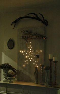 Mijn kerstdecoratie van dit jaar gemaakt van 2 planken 2 latjes slinger met 50 lampjes  en een handige man die het voor mij gemaakt heeft.