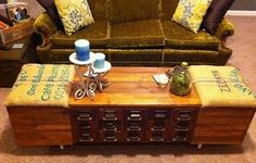 This vintage card catalog turned- coffee table and ottoman storage was designed by Luke Williams  and   constructed by Dan Williams.