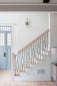 BANISTER:  Stairway painted in Sherwin Williams' Alabaster (both walls and trim) - Brittany of Addison's Wonderland
