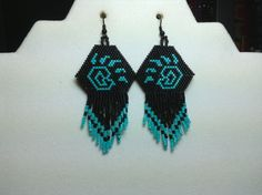 Hey, I found this really awesome Etsy listing at http://www.etsy.com/listing/158620756/native-bear-paw-beaded-earrings-with