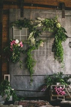 Use only flowers and greenery, or combine with other decorative elements like window panes, shutters, or reclaimed corrugated steel siding @myweddingdotcom