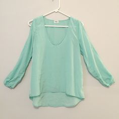 TOBI Mint Green Open Shoulder Blouse This beautiful v-neck blouse is lightweight and perfect for spring and summer! Open shoulder that extends all the way down to the wrist. In great, like new condition. No holes, stains or imperfections / comes from a smoke free environment Bundles welcome Offers welcome through offer button. ❌NO trades, please. ⚡️Same/Next day shipping Tobi Tops Blouses