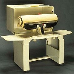 Mangle ironer - I remember one of these in a back bedroom. I never saw my grandmother ironing at all, much less using this thing. Her's was alwys closed up. I remember seeing it opened once. I thought (and still do) that this is one of the strangest looking inventions ever.